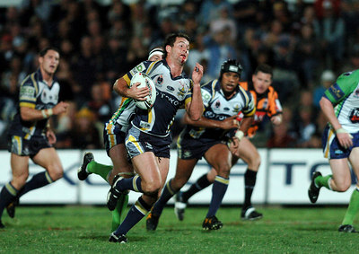 20 AUG 2005 TOWNSVILLE, QLD - Aaron Payne breaks through the Raiders defensive line - North Queensland Cowboys v Canberra Raiders (Dairy Farmers Stadium, Townsville) - PHOTO: CAMERON LAIRD