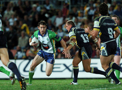 20 AUG 2005 TOWNSVILLE, QLD - Raider Phil Graham runs at the Cowboys line - North Queensland Cowboys v Canberra Raiders (Dairy Farmers Stadium, Townsville) - PHOTO: CAMERON LAIRD