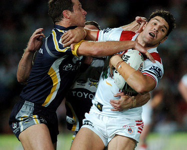 05 AUG 2005 TOWNSVILLE, QLD - Paul Bowman tries to bring down Trent Barrett - (North Queensland Cowboys v St George Illawarra Dragons, Dairy Farmers Stadium, Townsville) - PHOTO: CAMERON LAIRD