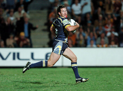 20 AUG 2005 TOWNSVILLE, QLD - Aaron Payne smiles at the camera as he scores a second half try - North Queensland Cowboys v Canberra Raiders (Dairy Farmers Stadium, Townsville) - PHOTO: CAMERON LAIRD