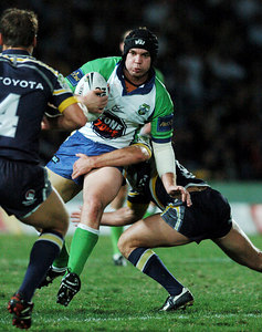 20 AUG 2005 TOWNSVILLE, QLD - Raider Troy Thompson carries the ball - North Queensland Cowboys v Canberra Raiders (Dairy Farmers Stadium, Townsville) - PHOTO: CAMERON LAIRD