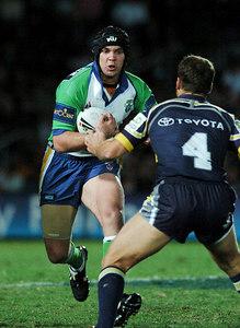 20 AUG 2005 TOWNSVILLE, QLD - Troy Thompson runs at Cowboys centre Paul Bowman - North Queensland Cowboys v Canberra Raiders (Dairy Farmers Stadium, Townsville) - PHOTO: CAMERON LAIRD