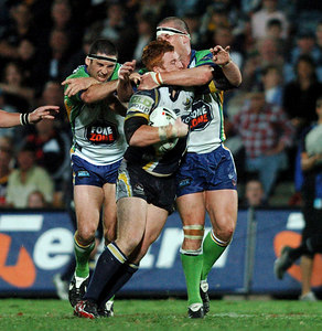 20 AUG 2005 TOWNSVILLE, QLD - Steve Southern is wrapped up by Jason Smith - North Queensland Cowboys v Canberra Raiders (Dairy Farmers Stadium, Townsville) - PHOTO: CAMERON LAIRD