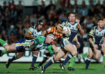 20 AUG 2005 TOWNSVILLE, QLD - Aaron Payne breaks through the Raiders line and escapes a Jason Smith tackle to score a second half try - North Queensland Cowboys v Canberra Raiders (Dairy Farmers Stadium, Townsville) - PHOTO: CAMERON LAIRD