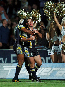 20 AUG 2005 TOWNSVILLE, QLD - Ty Williams congratulates Aaron Payne on a second half try - North Queensland Cowboys v Canberra Raiders (Dairy Farmers Stadium, Townsville) - PHOTO: CAMERON LAIRD