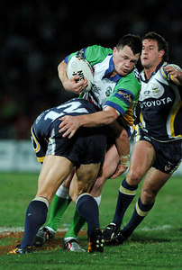 20 AUG 2005 TOWNSVILLE, QLD - Raider Ben Cross is caught in a Cowboys tackle - North Queensland Cowboys v Canberra Raiders (Dairy Farmers Stadium, Townsville) - PHOTO: CAMERON LAIRD