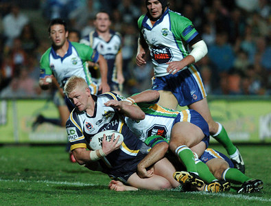 20 AUG 2005 TOWNSVILLE, QLD - Mitchell Sargent is wrapped up - North Queensland Cowboys v Canberra Raiders (Dairy Farmers Stadium, Townsville) - PHOTO: CAMERON LAIRD