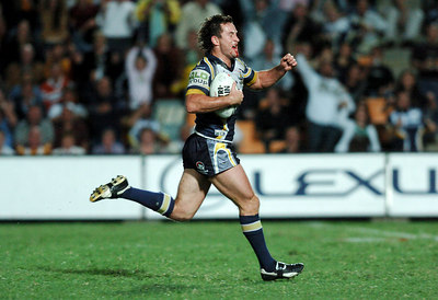 20 AUG 2005 TOWNSVILLE, QLD - Aaron Payne pumps his fist in delight as he scores a second half try - North Queensland Cowboys v Canberra Raiders (Dairy Farmers Stadium, Townsville) - PHOTO: CAMERON LAIRD