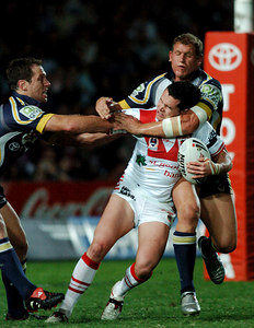 05 AUG 2005 TOWNSVILLE, QLD - Dean Young is caught around the neck by Travis Norton - (North Queensland Cowboys v St George Illawarra Dragons, Dairy Farmers Stadium, Townsville) - PHOTO: CAMERON LAIRD