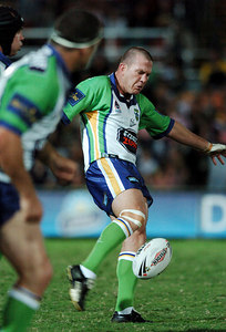 20 AUG 2005 TOWNSVILLE, QLD - Raiders five-eighth Jason Smith kicks on the fifth tackle - North Queensland Cowboys v Canberra Raiders (Dairy Farmers Stadium, Townsville) - PHOTO: CAMERON LAIRD