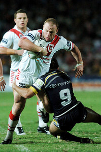 05 AUG 2005 TOWNSVILLE, QLD - Luke Bailey is wrapped up by Paul Bowman - (North Queensland Cowboys v St George Illawarra Dragons, Dairy Farmers Stadium, Townsville) - PHOTO: CAMERON LAIRD