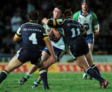 20 AUG 2005 TOWNSVILLE, QLD - Kris Kahler is tackled by Cowboys second rower Steve Southern - North Queensland Cowboys v Canberra Raiders (Dairy Farmers Stadium, Townsville) - PHOTO: CAMERON LAIRD
