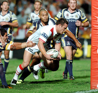 05 AUG 2005 TOWNSVILLE, QLD - Dean Young scores a try in the first half despite the best efforts of Carl Webb and Paul Rauhihi - (North Queensland Cowboys v St George Illawarra Dragons, Dairy Farmers Stadium, Townsville) - PHOTO: CAMERON LAIRD
