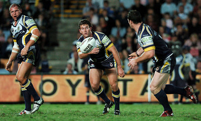 20 AUG 2005 TOWNSVILLE, QLD - Aaron Payne passes to Brett Firmin - North Queensland Cowboys v Canberra Raiders (Dairy Farmers Stadium, Townsville) - PHOTO: CAMERON LAIRD