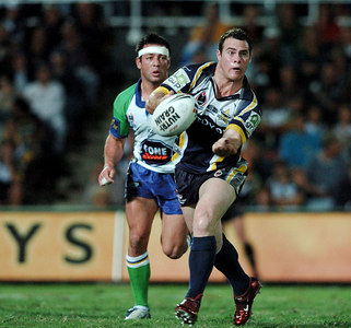 20 AUG 2005 TOWNSVILLE, QLD - Brett Firmin passes - North Queensland Cowboys v Canberra Raiders (Dairy Farmers Stadium, Townsville) - PHOTO: CAMERON LAIRD