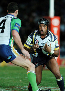 20 AUG 2005 TOWNSVILLE, QLD - Ty Williams runs at Raiders centre Adam Mogg - North Queensland Cowboys v Canberra Raiders (Dairy Farmers Stadium, Townsville) - PHOTO: CAMERON LAIRD