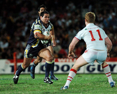 05 AUG 2005 TOWNSVILLE, QLD - Carl Webb runs at Ben Creagh - (North Queensland Cowboys v St George Illawarra Dragons, Dairy Farmers Stadium, Townsville) - PHOTO: CAMERON LAIRD