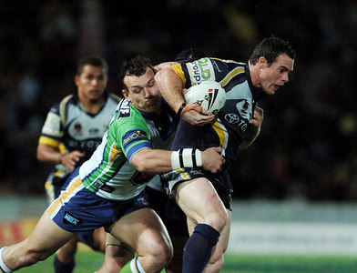 20 AUG 2005 TOWNSVILLE, QLD - Brett Firman tries to break through a Raiders tackle - North Queensland Cowboys v Canberra Raiders (Dairy Farmers Stadium, Townsville) - PHOTO: CAMERON LAIRD