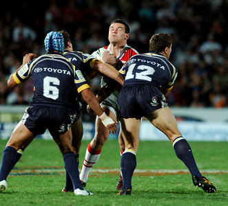 05 AUG 2005 TOWNSVILLE, QLD - Jason Ryles is hit hard by Paul Bowman and Luke O'Donnell - (North Queensland Cowboys v St George Illawarra Dragons, Dairy Farmers Stadium, Townsville) - PHOTO: CAMERON LAIRD