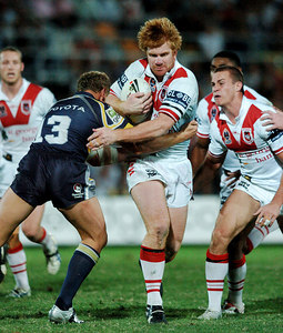 05 AUG 2005 TOWNSVILLE, QLD - Dragons powerhouse Lance Thompson smashes into Travis Norton - (North Queensland Cowboys v St George Illawarra Dragons, Dairy Farmers Stadium, Townsville) - PHOTO: CAMERON LAIRD