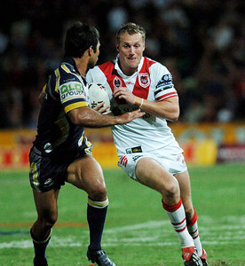 05 AUG 2005 TOWNSVILLE, QLD - Mark Gasnier tries to step around Matt Sing - (North Queensland Cowboys v St George Illawarra Dragons, Dairy Farmers Stadium, Townsville) - PHOTO: CAMERON LAIRD