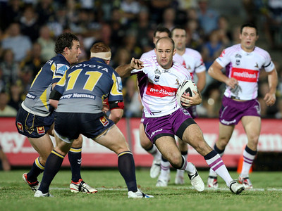 26 April 2008 Townsville, Qld - MAtt Geyer runs at Aaron Payne and Steve Southern in the first half - North Queensland Cowboys v Melbourne Storm (Dairy Farmers Stadium) - Photo: Cameron Laird (Ph: 0418 238811)