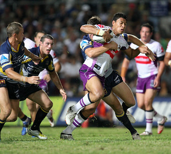 26 April 2008 Townsville, Qld - Israel Folau tries to escape to Cowboys defence - North Queensland Cowboys v Melbourne Storm (Dairy Farmers Stadium) - Photo: Cameron Laird (Ph: 0418 238811)