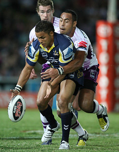 26 April 2008 Townsville, Qld - Antonio Kaufusi takes out Matt Bowen giving the Cowboys a first half penalty - North Queensland Cowboys v Melbourne Storm (Dairy Farmers Stadium) - Photo: Cameron Laird (Ph: 0418 238811)