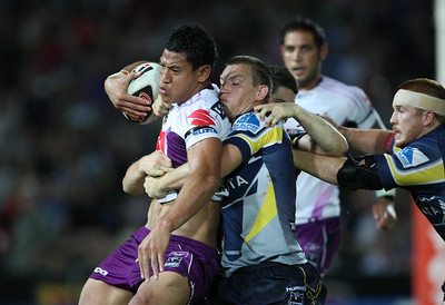 26 April 2008 Townsville, Qld - Mark Henry pushes Israel Folau towards the sideline - North Queensland Cowboys v Melbourne Storm (Dairy Farmers Stadium) - Photo: Cameron Laird (Ph: 0418 238811)