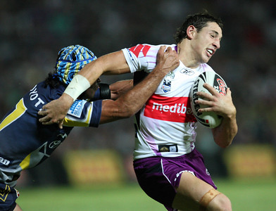 26 April 2008 Townsville, Qld - Johnathan Thurston caught Storm fullback Billy Slater in the eye during a first half tackle - North Queensland Cowboys v Melbourne Storm (Dairy Farmers Stadium) - Photo: Cameron Laird (Ph: 0418 238811)