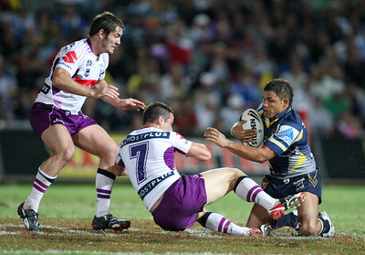 26 April 2008 Townsville, Qld - Matt Bowen pushes off Cooper Cronk during the second half - North Queensland Cowboys v Melbourne Storm (Dairy Farmers Stadium) - Photo: Cameron Laird (Ph: 0418 238811)