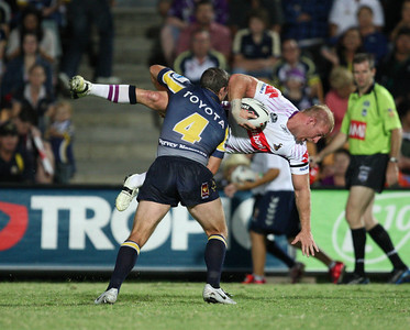 26 April 2008 Townsville, Qld - Michael Crocker is upended by Cowboy centre Ben Harris - North Queensland Cowboys v Melbourne Storm (Dairy Farmers Stadium) - Photo: Cameron Laird (Ph: 0418 238811)