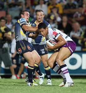 26 April 2008 Townsville, Qld - Israel Folau and Ben Harris come together in the first half - North Queensland Cowboys v Melbourne Storm (Dairy Farmers Stadium) - Photo: Cameron Laird (Ph: 0418 238811)