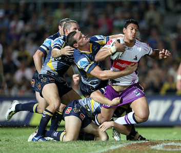 26 April 2008 Townsville, Qld - Ray Cashmere tries to pull down a charging Israel Folau - North Queensland Cowboys v Melbourne Storm (Dairy Farmers Stadium) - Photo: Cameron Laird (Ph: 0418 238811)