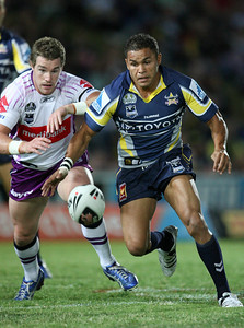 26 April 2008 Townsville, Qld - Anthony Quinn and Matt Bowen chase a loose ball - North Queensland Cowboys v Melbourne Storm (Dairy Farmers Stadium) - Photo: Cameron Laird (Ph: 0418 238811)