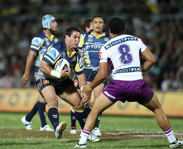 26 April 2008 Townsville, Qld - Carl Webb runs at Melbourne's Adam Blair - North Queensland Cowboys v Melbourne Storm (Dairy Farmers Stadium) - Photo: Cameron Laird (Ph: 0418 238811)