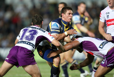 26 April 2008 Townsville, Qld - Jacob Lillyman runs into Adam Blair (8) and Dallas Johnson (13) - North Queensland Cowboys v Melbourne Storm (Dairy Farmers Stadium) - Photo: Cameron Laird (Ph: 0418 238811)
