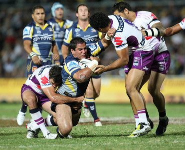 26 April 2008 Townsville, Qld - Carl Webb is wrapped up by the Storm defence - North Queensland Cowboys v Melbourne Storm (Dairy Farmers Stadium) - Photo: Cameron Laird (Ph: 0418 238811)