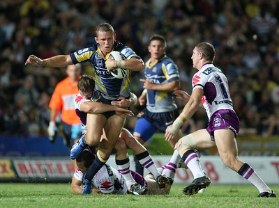 26 April 2008 Townsville, Qld - Justin Smith tries to break clear of the Storm pack - North Queensland Cowboys v Melbourne Storm (Dairy Farmers Stadium) - Photo: Cameron Laird (Ph: 0418 238811)