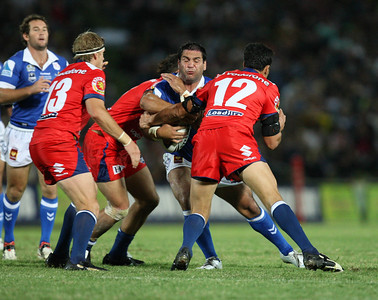 19 April 2008 Townsville, Qld - Carl Webb is wrapped up by the Warriors defence - North Queensland Cowboys v New Zealand Warriors (Dairy Farmers Stadium) - Photo: Cameron Laird (Ph: 0418 238811)