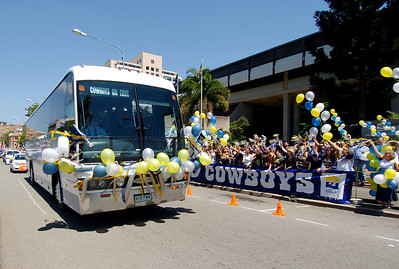 24-SEP-2004  TOWNSVILLE, QLD - The Cowboys team bus passes the council chambers at the team leave for their clash with the Roosters - PHOTO: CAMERON LAIRD