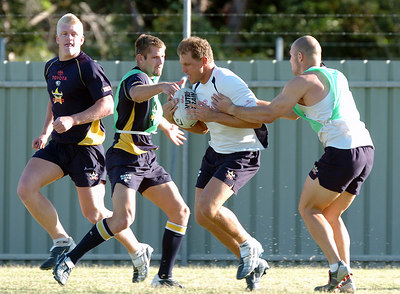 22-SEP-2004  TOWNSVILLE, QLD - Cowboys training (from left) Mitchell Sargent, Neil Sweeney, Travis Norton and Leigh McWilliams - PHOTO: CAMERON LAIRD