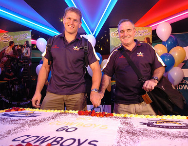 24-SEP-2004  TOWNSVILLE, QLD - Travis Norton and Graham Murray cut a 'good luck' cake as they prepare to leave for their clash with the Roosters - PHOTO: CAMERON LAIRD