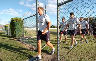 22-SEP-2004  TOWNSVILLE, QLD - Cowboys captain Travis Norton leads his players off the training paddock - PHOTO: CAMERON LAIRD
