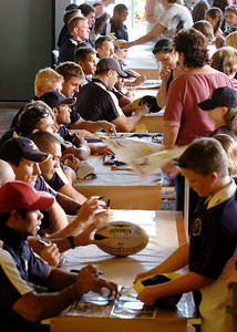 21-SEP-2004  TOWNSVILLE, QLD - Cowboys players are swamped by young fans at a public autograph session - PHOTO: CAMERON LAIRD