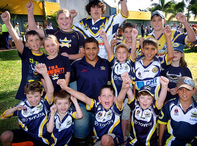 21-SEP-2004  TOWNSVILLE, QLD - Cowboys fullback Matt Bowen is swamped by young fans at a public autograph session - PHOTO: CAMERON LAIRD