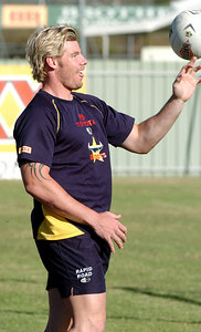 22-SEP-2004  TOWNSVILLE, QLD - Glenn Morrison show his ball skills at training - PHOTO: CAMERON LAIRD