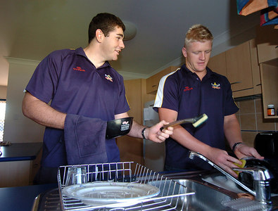 22-SEP-2004  TOWNSVILLE, QLD - Mitchell Sargent (right) has taken in a 'homeless' Shane Tronc who looks pretty handy around the house - PHOTO: CAMERON LAIRD