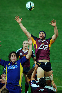 12 MAY 2006 TOWNSVILLE, QLD - Mark Connors flies high in a linout during the Queensland Reds Super 14 match against the Highlanders at Dairy Farmers Stadium, Townsville - PHOTO: CAMERON LAIRD