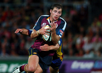 12 MAY 2006 TOWNSVILLE, QLD - Reds centre Andrew Brown charges with the ball during his teams 22-16 win over the Highlanders in their Super 14 clash at Dairy Farmers Stadium, Townsville - PHOTO: CAMERON LAIRD